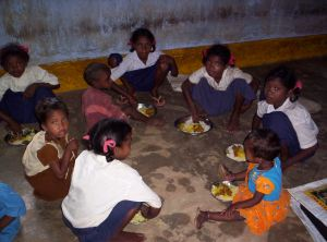 Children having mid day meal in school