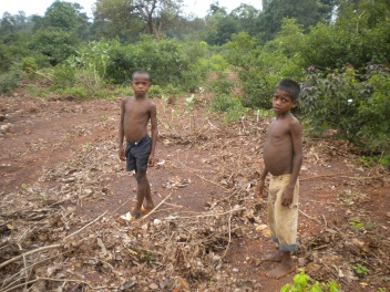 Children on barren land cause by mining